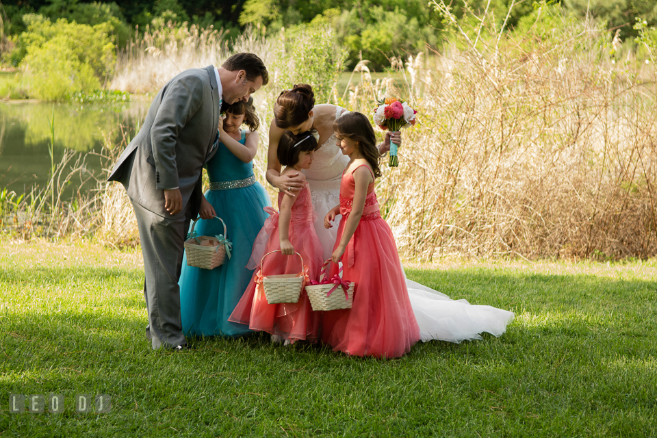 Bride and Groom hugging their children and flower girls after the ceremony. Chesapeake Bay Environmental Center, Eastern Shore Maryland, wedding reception and ceremony photo, by wedding photographers of Leo Dj Photography. http://leodjphoto.com