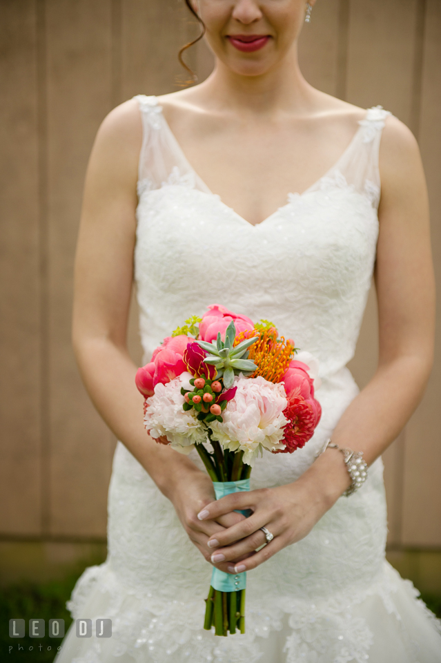 Bride's bouquet of dark and light pink peonies, succulents, protea, hypericum berries, and peach dahlias designed by the florist Magnolia Floral Design. Chesapeake Bay Environmental Center, Eastern Shore Maryland, wedding reception and ceremony photo, by wedding photographers of Leo Dj Photography. http://leodjphoto.com