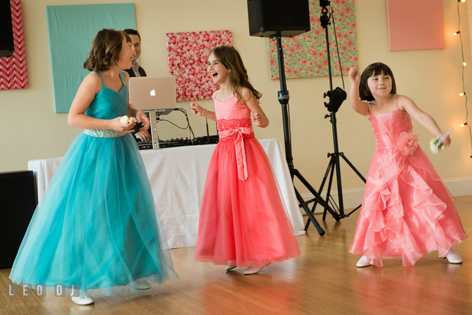 The flower girls dancing along to the introductory song from James Brown, I Got You, I Feel Good. Chesapeake Bay Environmental Center, Eastern Shore Maryland, wedding reception and ceremony photo, by wedding photographers of Leo Dj Photography. http://leodjphoto.com