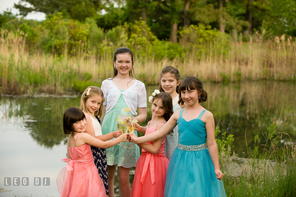 The flower girls toast to the Bride and Groom. Chesapeake Bay Environmental Center, Eastern Shore Maryland, wedding reception and ceremony photo, by wedding photographers of Leo Dj Photography. http://leodjphoto.com
