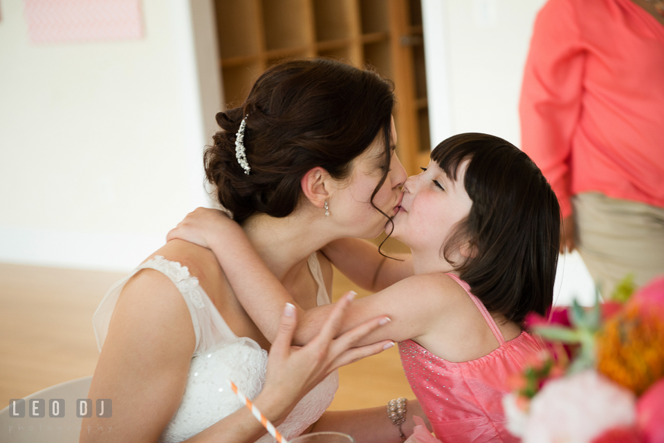 The Bride kissing one of the flower girls. Chesapeake Bay Environmental Center, Eastern Shore Maryland, wedding reception and ceremony photo, by wedding photographers of Leo Dj Photography. http://leodjphoto.com
