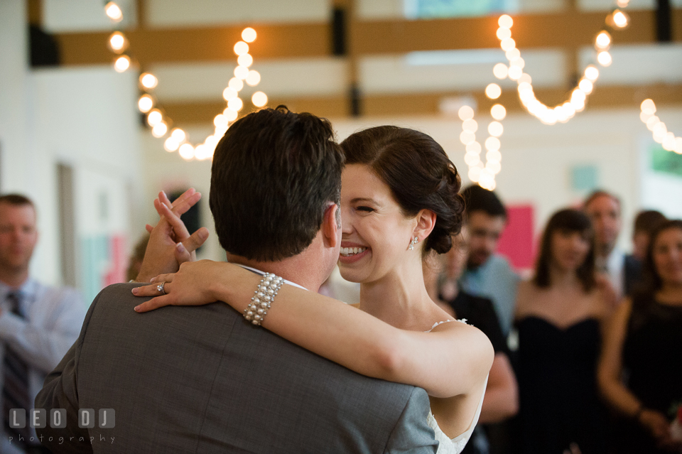Bride and Groom smiling during their first dance. Chesapeake Bay Environmental Center, Eastern Shore Maryland, wedding reception and ceremony photo, by wedding photographers of Leo Dj Photography. http://leodjphoto.com