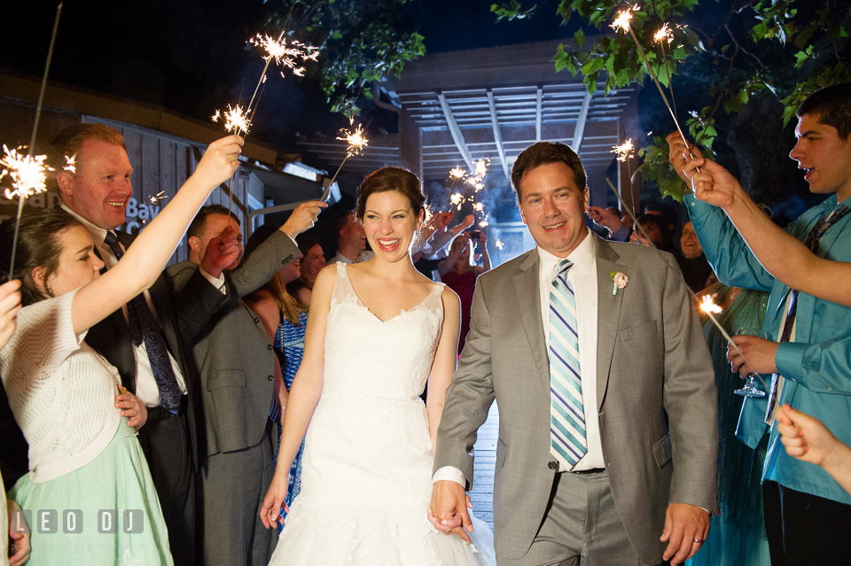 Bride and Groom had a grand exit by going through a row of guests holding sparklers. Chesapeake Bay Environmental Center, Eastern Shore Maryland, wedding reception and ceremony photo, by wedding photographers of Leo Dj Photography. http://leodjphoto.com