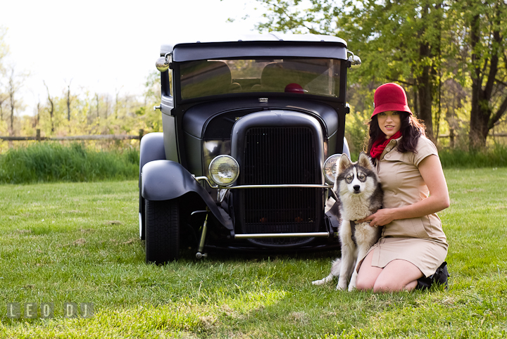 Girl and her dog posing by an antique Ford model car. Model portrait session with Brittany from Beyond the Veil music Band and her Siberian Husky pet dog at Kent Island, Maryland Eastern Shore by photographer Leo Dj Photography.