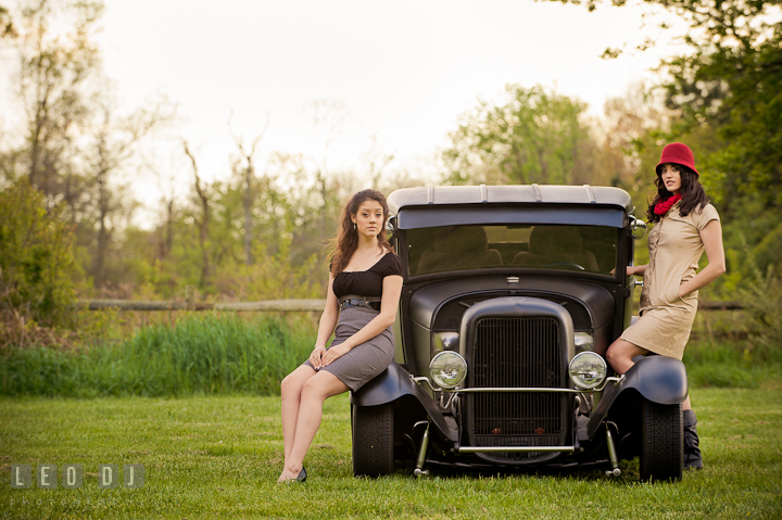 High school senior girl and her sister posing by a vintage Ford model car. Model portrait session with Brittany from Beyond the Veil music Band and her Siberian Husky pet dog at Kent Island, Maryland Eastern Shore by photographer Leo Dj Photography.