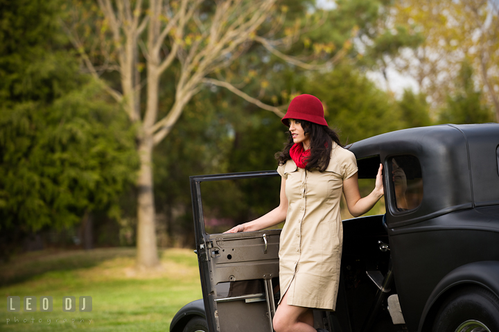 Girl stepping out of an antique Ford model car. Model portrait session with Brittany from Beyond the Veil music Band and her Siberian Husky pet dog at Kent Island, Maryland Eastern Shore by photographer Leo Dj Photography.