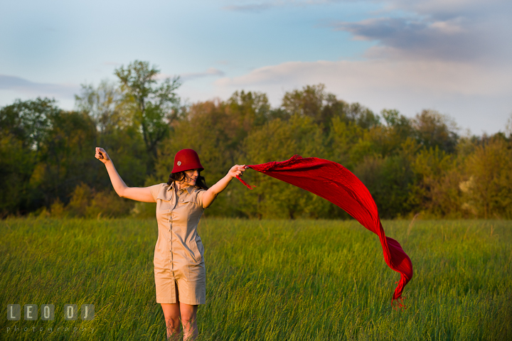 Girl with vintage red hat playing with red scarf blowing in the wind. Model portrait session with Brittany from Beyond the Veil music Band and her Siberian Husky pet dog at Kent Island, Maryland Eastern Shore by photographer Leo Dj Photography.