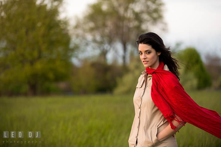 Girl with red scarf in a grass meadow. Model portrait session with Brittany from Beyond the Veil music Band and her Siberian Husky pet dog at Kent Island, Maryland Eastern Shore by photographer Leo Dj Photography.