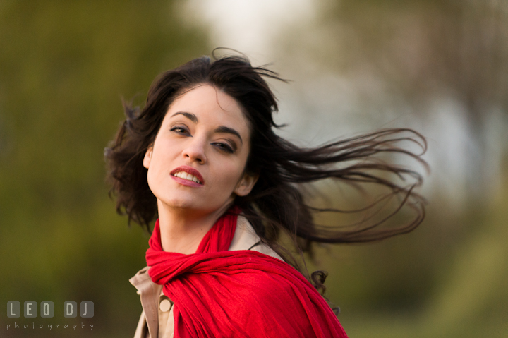 Girl with red scarf have her hair blown by the wind. Model portrait session with Brittany from Beyond the Veil music Band and her Siberian Husky pet dog at Kent Island, Maryland Eastern Shore by photographer Leo Dj Photography.