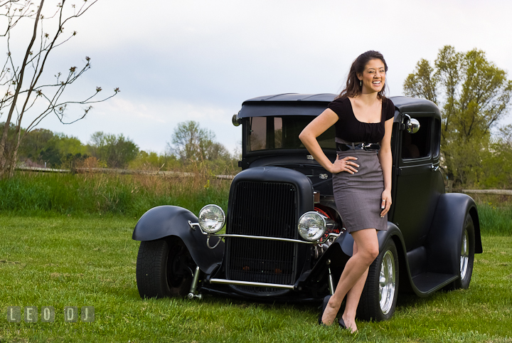 Girl laughing in front of an old Ford car. Eastern Shore, Maryland, Kent Island High School senior portrait session by photographer Leo Dj Photography. http://leodjphoto.com