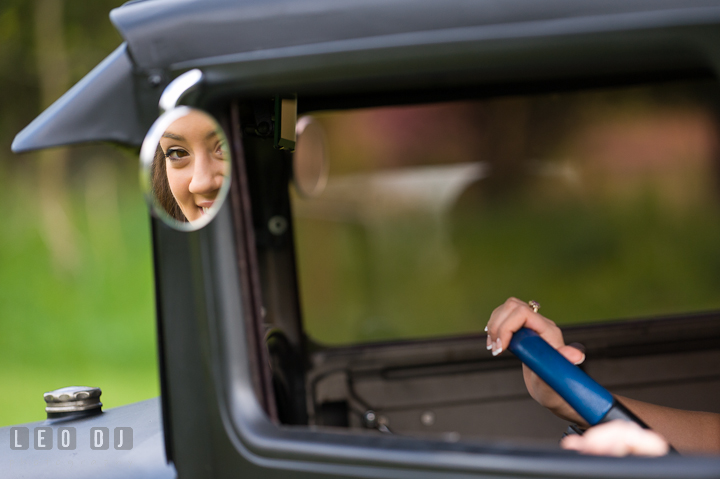 Girl's face seen from car side view mirror. Eastern Shore, Maryland, Kent Island High School senior portrait session by photographer Leo Dj Photography. http://leodjphoto.com
