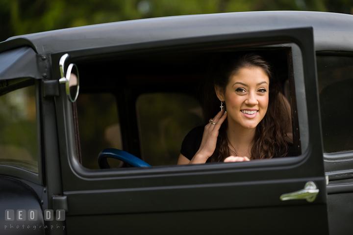 Girl smiling inside an antique Ford car. Eastern Shore, Maryland, Kent Island High School senior portrait session by photographer Leo Dj Photography. http://leodjphoto.com
