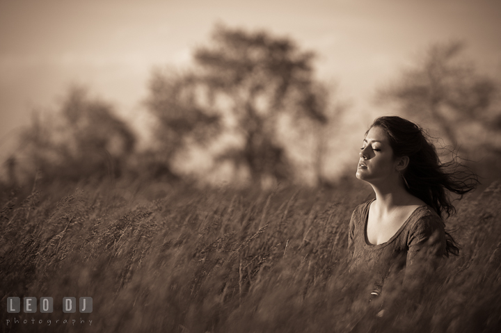 Girl in a grass meadow enjoying the wind on her face. Eastern Shore, Maryland, Kent Island High School senior portrait session by photographer Leo Dj Photography. http://leodjphoto.com