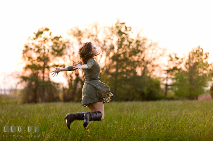Girl jumping high up in the air in a grass meadow. Eastern Shore, Maryland, Kent Island High School senior portrait session by photographer Leo Dj Photography. http://leodjphoto.com