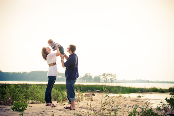 Family on the beach. Mother holding baby up in the air. Eastern Shore Maryland Kent Island Family Lifestyle Portrait Photo Session by Photographer Leo Dj Photography