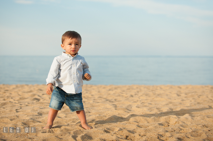 Little toddler boy standing on the beach. Kent Island, Annapolis, Eastern Shore Maryland candid children and family lifestyle portrait photo session by photographers of Leo Dj Photography. http://leodjphoto.com