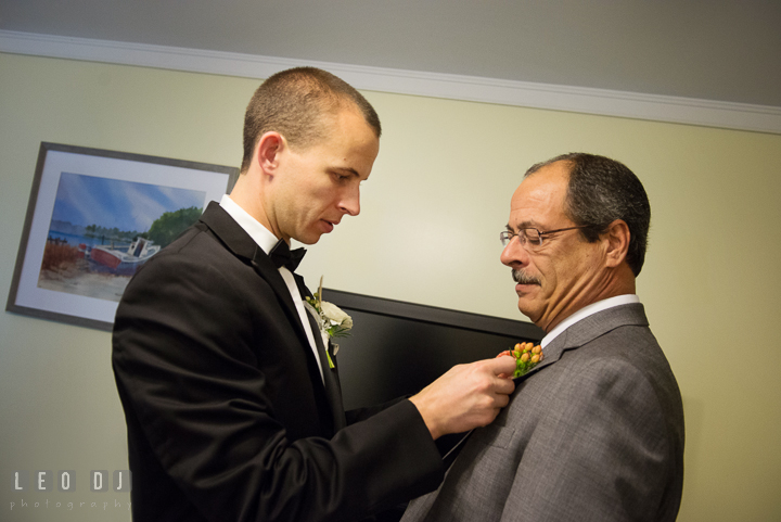 Groom put boutonniere for Father. Aspen Wye River Conference Centers wedding at Queenstown Maryland, by wedding photographers of Leo Dj Photography. http://leodjphoto.com