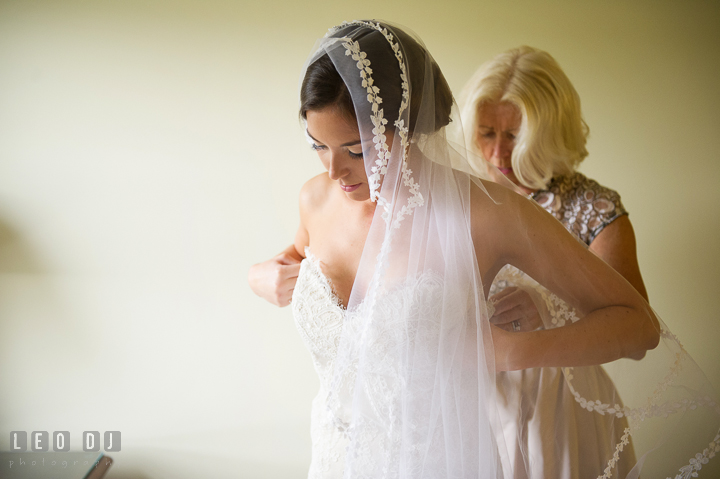 Mother of Bride buttoning up daugther's wedding dress. Aspen Wye River Conference Centers wedding at Queenstown Maryland, by wedding photographers of Leo Dj Photography. http://leodjphoto.com