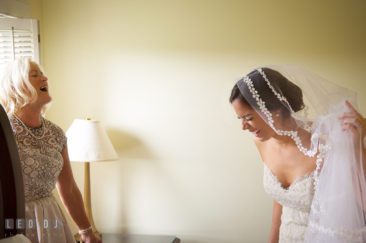 Mother of Bride and daughter laughing together during getting ready. Aspen Wye River Conference Centers wedding at Queenstown Maryland, by wedding photographers of Leo Dj Photography. http://leodjphoto.com