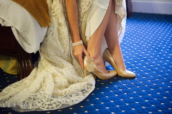 Bride putting on art deco Gatsby style wedding shoes. Aspen Wye River Conference Centers wedding at Queenstown Maryland, by wedding photographers of Leo Dj Photography. http://leodjphoto.com