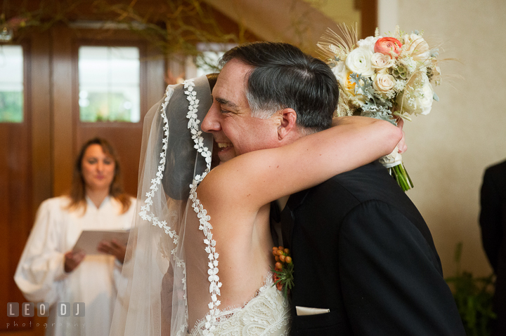 Bride hugging Father who is giving away his daughter to Groom. Aspen Wye River Conference Centers wedding at Queenstown Maryland, by wedding photographers of Leo Dj Photography. http://leodjphoto.com