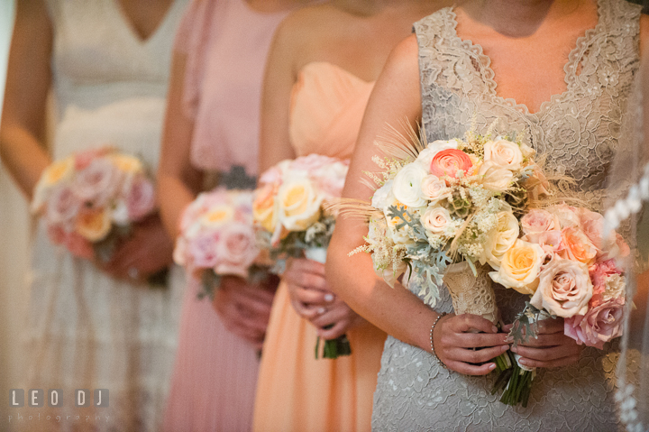 Maid of Honor and Bridesmaids holding their flower bouquets by Mobtown Florals. Aspen Wye River Conference Centers wedding at Queenstown Maryland, by wedding photographers of Leo Dj Photography. http://leodjphoto.com