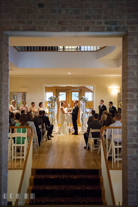 Wide view of the ceremony showing Bride, Groom, wedding party and guests. Aspen Wye River Conference Centers wedding at Queenstown Maryland, by wedding photographers of Leo Dj Photography. http://leodjphoto.com