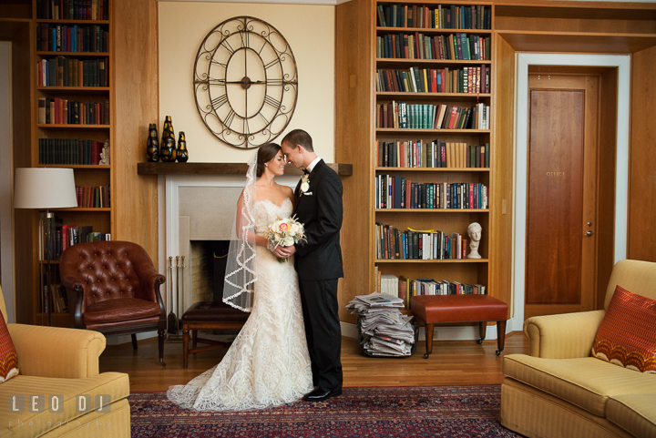 Romantic photo session of Bride and Groom in the Riverhouse Library. Aspen Wye River Conference Centers wedding at Queenstown Maryland, by wedding photographers of Leo Dj Photography. http://leodjphoto.com