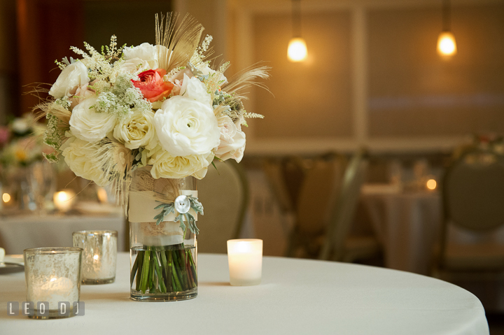 Bride's flower bouquet with white and pastel roses by Mobtown Florals on sweetheart table. Aspen Wye River Conference Centers wedding at Queenstown Maryland, by wedding photographers of Leo Dj Photography. http://leodjphoto.com