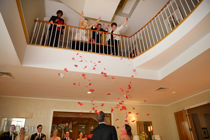 Wedding coordinator and Father and Mother of Bride throw heart shaped confetti from above to Bride and Groom. Aspen Wye River Conference Centers wedding at Queenstown Maryland, by wedding photographers of Leo Dj Photography. http://leodjphoto.com