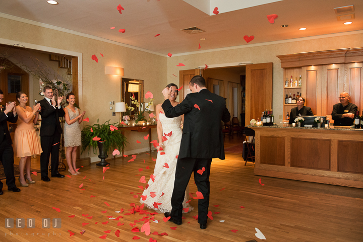 Bride and Groom showered with heart-shaped confetti from above. Aspen Wye River Conference Centers wedding at Queenstown Maryland, by wedding photographers of Leo Dj Photography. http://leodjphoto.com