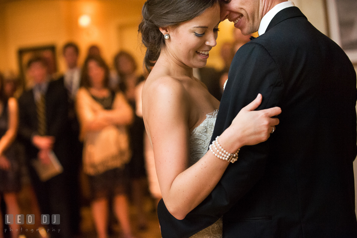 Bride and Groom cuddling and smiling while doing first dance. Aspen Wye River Conference Centers wedding at Queenstown Maryland, by wedding photographers of Leo Dj Photography. http://leodjphoto.com