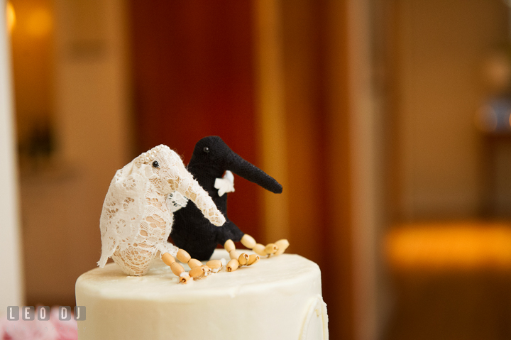 White and Black kiwi bird cake toppers made with laces representing the Bride and Groom. Aspen Wye River Conference Centers wedding at Queenstown Maryland, by wedding photographers of Leo Dj Photography. http://leodjphoto.com