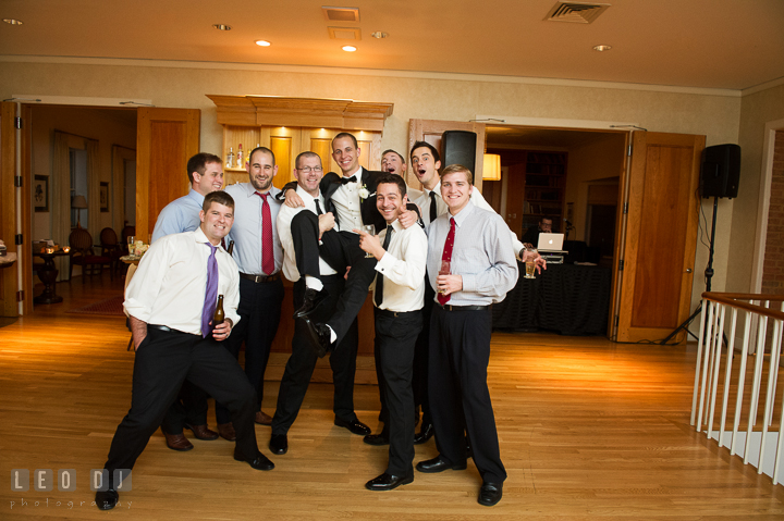 Groomsmen and friends lifted up Groom for silly pose. Aspen Wye River Conference Centers wedding at Queenstown Maryland, by wedding photographers of Leo Dj Photography. http://leodjphoto.com
