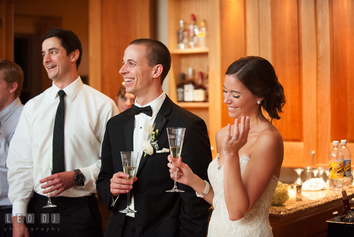 Bride, Groom and guests laughing, listening to Father of Bride's speech. Aspen Wye River Conference Centers wedding at Queenstown Maryland, by wedding photographers of Leo Dj Photography. http://leodjphoto.com