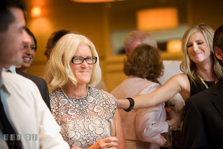 Mother of Bride smiling and emotional hearing speech from Father of Bride. Aspen Wye River Conference Centers wedding at Queenstown Maryland, by wedding photographers of Leo Dj Photography. http://leodjphoto.com