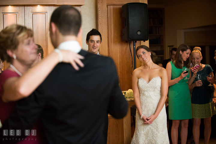 Bride in awe observing Mother-Son dance. Aspen Wye River Conference Centers wedding at Queenstown Maryland, by wedding photographers of Leo Dj Photography. http://leodjphoto.com