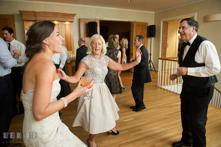 Bride having fun dancing with her Father and Mother. Aspen Wye River Conference Centers wedding at Queenstown Maryland, by wedding photographers of Leo Dj Photography. http://leodjphoto.com