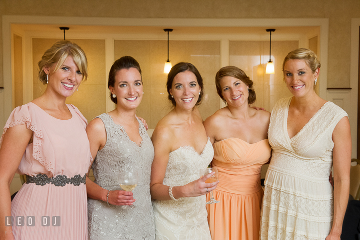 Bride posing with maid of honor and bridesmaids. Aspen Wye River Conference Centers wedding at Queenstown Maryland, by wedding photographers of Leo Dj Photography. http://leodjphoto.com