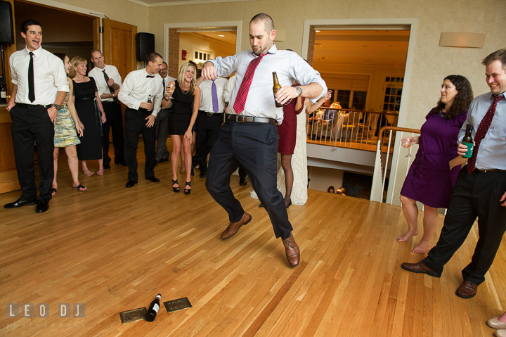 Guest dancing during spin the bottle game. Aspen Wye River Conference Centers wedding at Queenstown Maryland, by wedding photographers of Leo Dj Photography. http://leodjphoto.com