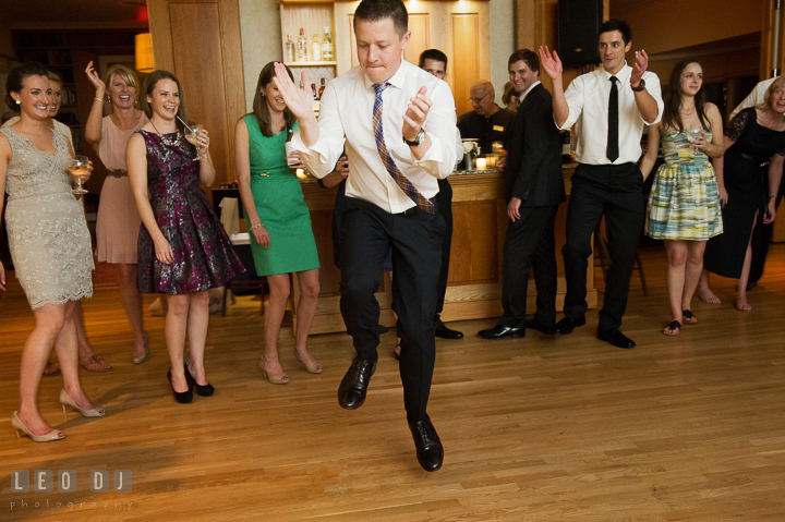 Guest jumping, clapping, and dancing with onlooker guests in the background. Aspen Wye River Conference Centers wedding at Queenstown Maryland, by wedding photographers of Leo Dj Photography. http://leodjphoto.com