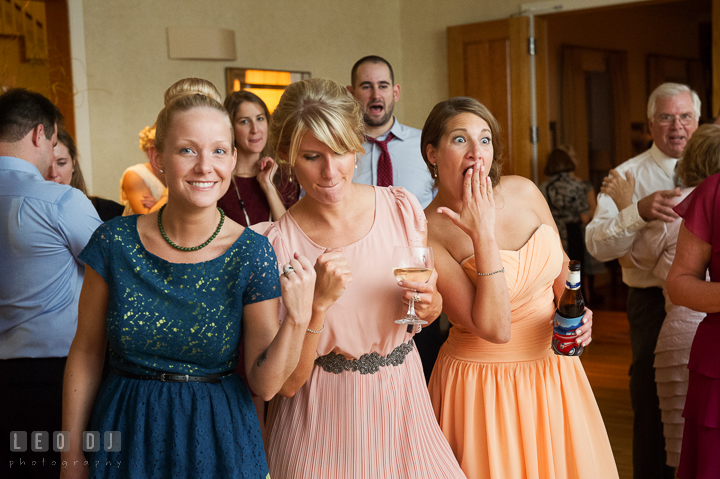 Bridesmaids and guests dancing and doing silly moves. Aspen Wye River Conference Centers wedding at Queenstown Maryland, by wedding photographers of Leo Dj Photography. http://leodjphoto.com