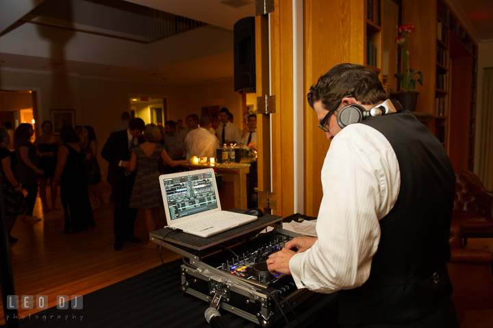 The DJ Chris Temple of C&J Entertainment mixing music. Aspen Wye River Conference Centers wedding at Queenstown Maryland, by wedding photographers of Leo Dj Photography. http://leodjphoto.com