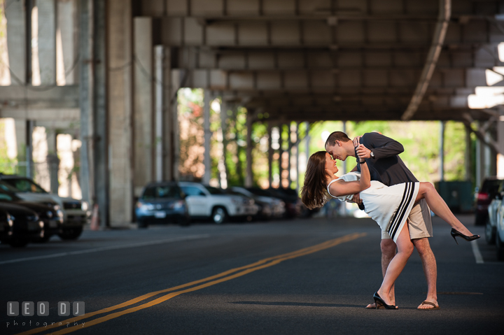 Engaged couple doing the dip under an overpass by the DC Waterfront. Georgetown Washington DC pre-wedding engagement photo session, by wedding photographers of Leo Dj Photography. http://leodjphoto.com