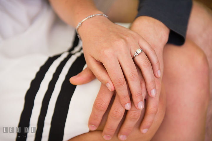 Engaged girl holding her fiancé's hand and showing her diamond engagement ring. Georgetown Washington DC pre-wedding engagement photo session, by wedding photographers of Leo Dj Photography. http://leodjphoto.com