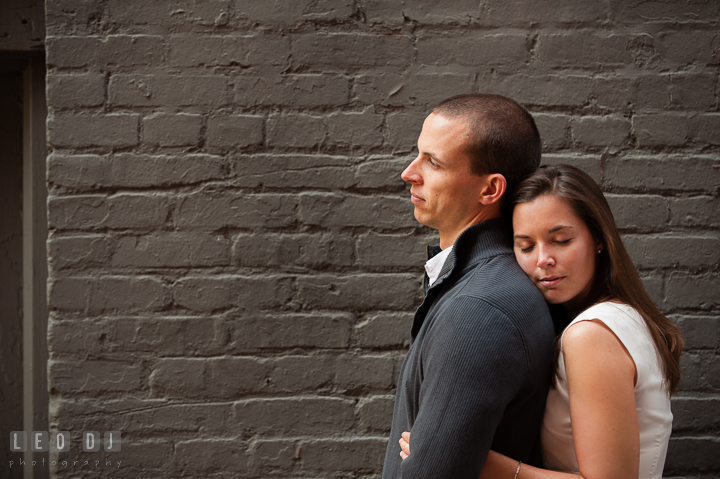 Engaged girl leaning her head on her fiancé's back. Georgetown Washington DC pre-wedding engagement photo session, by wedding photographers of Leo Dj Photography. http://leodjphoto.com