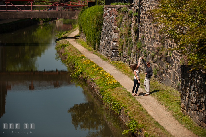 Engaged couple dancing by the C&O Canal. Georgetown Washington DC pre-wedding engagement photo session, by wedding photographers of Leo Dj Photography. http://leodjphoto.com