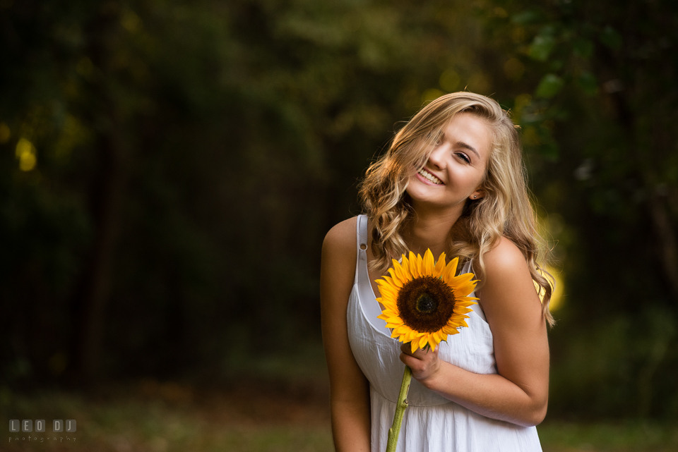 Kent Island High School Maryland senior with sunflower laughing photo by Leo Dj Photography