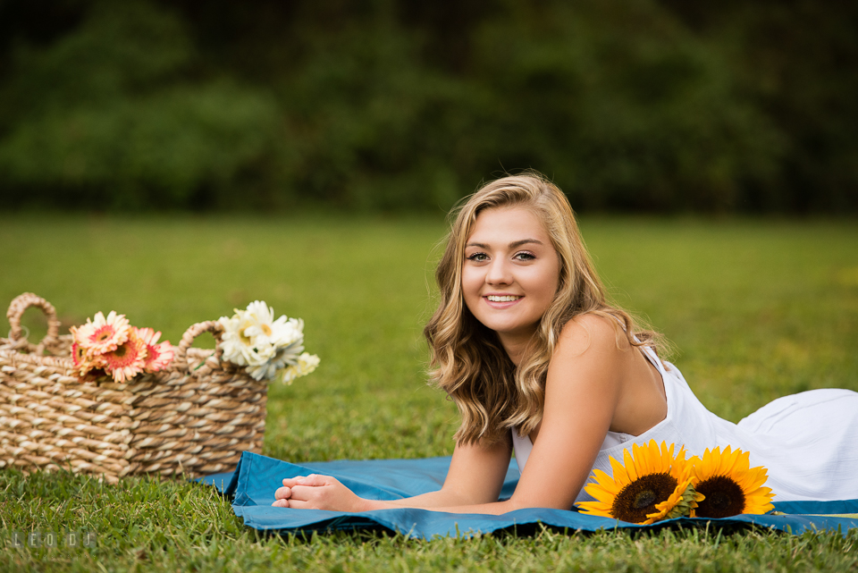 Kent Island High School Maryland senior with basket of flowers laying on ground photo by Leo Dj Photography