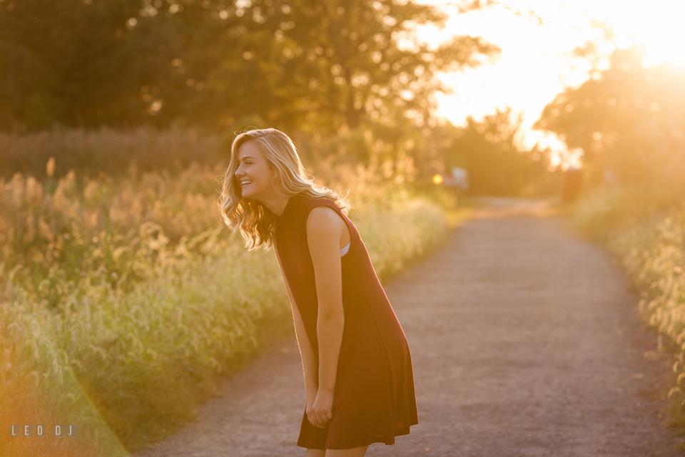 Kent Island High School Maryland senior on trail laughing photo by Leo Dj Photography
